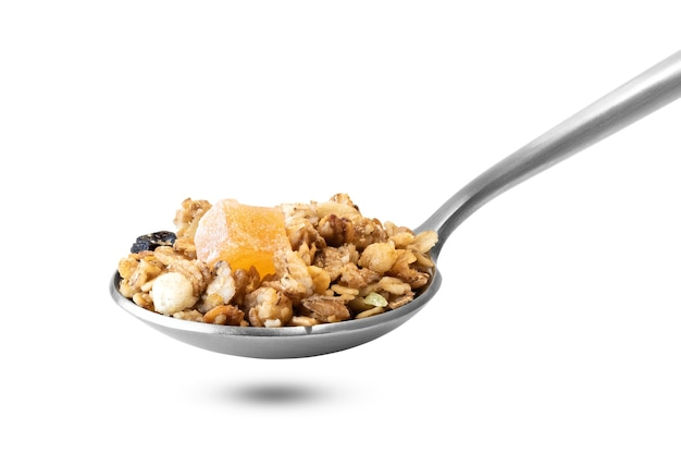 Heap of muesli in spoon isolated on white background