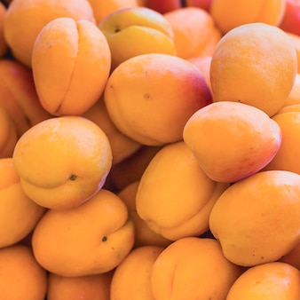 Куча свежих персиков Бесплатные Фотографии