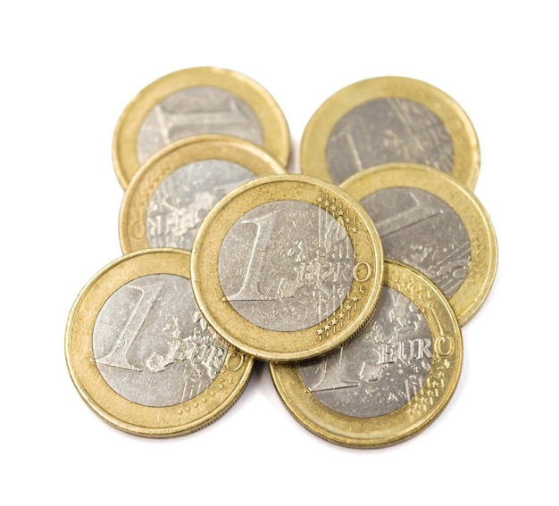 Heap of one euro coins isolated on white background.