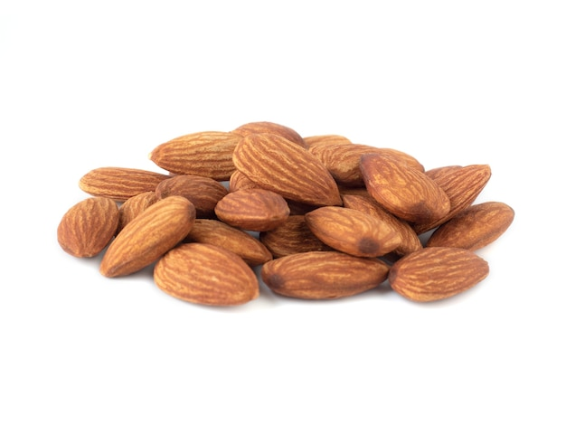 Heap of organic almonds isolated on white