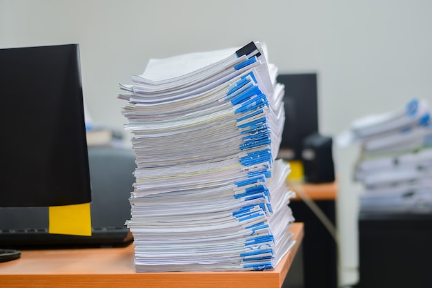 Heap of papers work stack documents on office desk