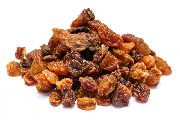 Heap of raisins on white table