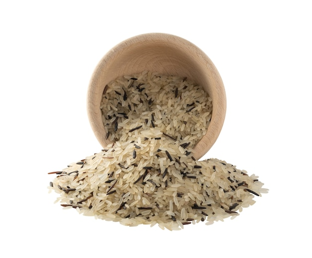Heap of raw dry black wild rice and parboiled long-grain white rice spilling out of round wood bowl isolated