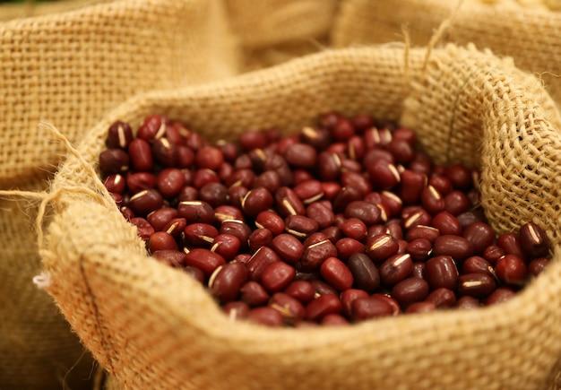 Heap of raw red mung bean or azuki bean in a natural hemp sack