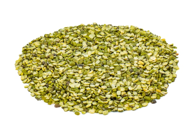 Heap of raw split mung bean lentils or mung dhal on white background
