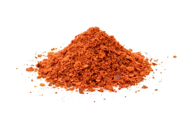 Heap red chili powder isolated on white background