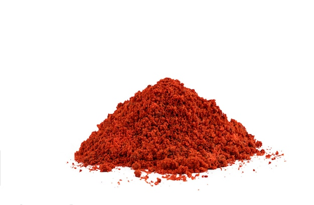 Heap red chili powder or paprika on a white background. high quality photo