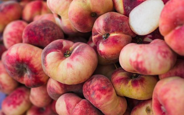 Heap of ripe fresh saturn peaches