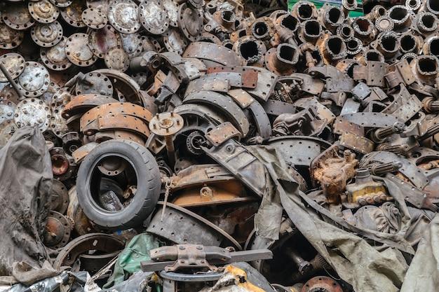 Heap of scrap and rust auto parts in junkyard