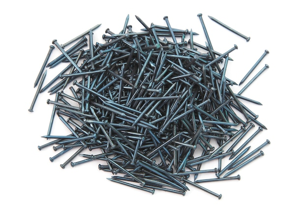 Heap of  silver concrete nails isolated on white.
