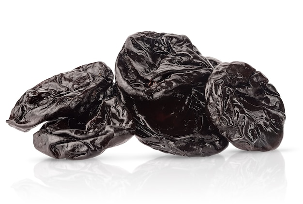Heap of smoked or dried plums isolated with clipping path on white background.