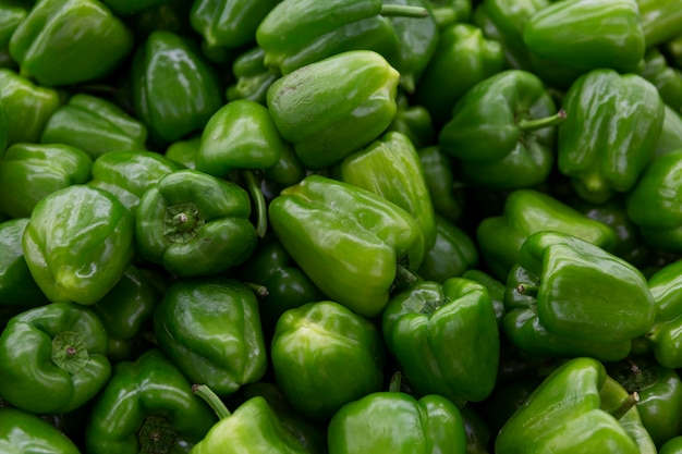 Heap of sweet green bell peppers. healthy food and vitamins during the cold season