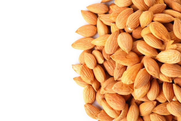 Heap of tasty almond isolated on white