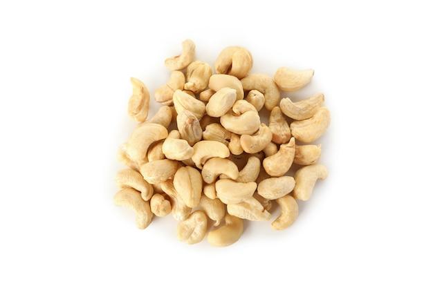 Heap of tasty cashew nuts on white
