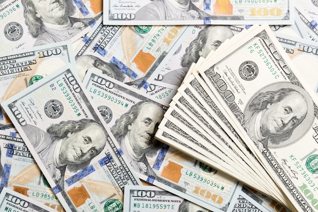 Heap of us dollar bills, money background. top view of business concept on background with copy space