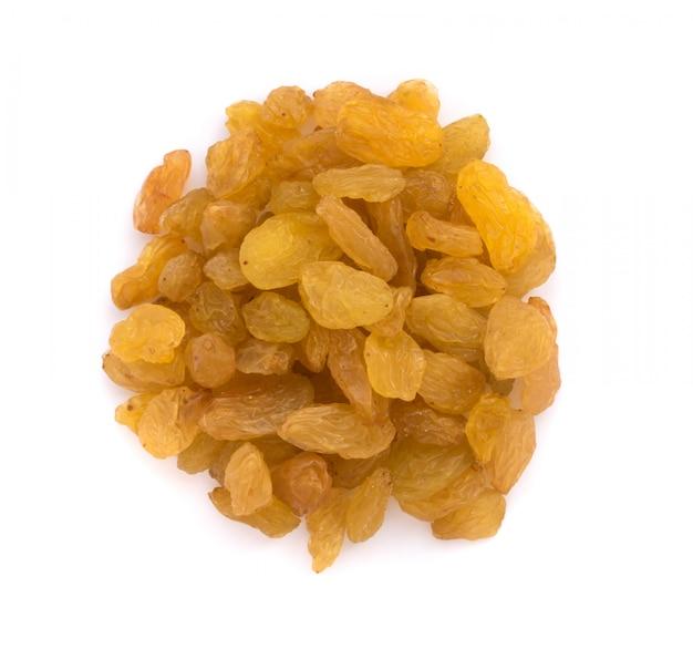 Heap of yellow sultanas raisins on white background