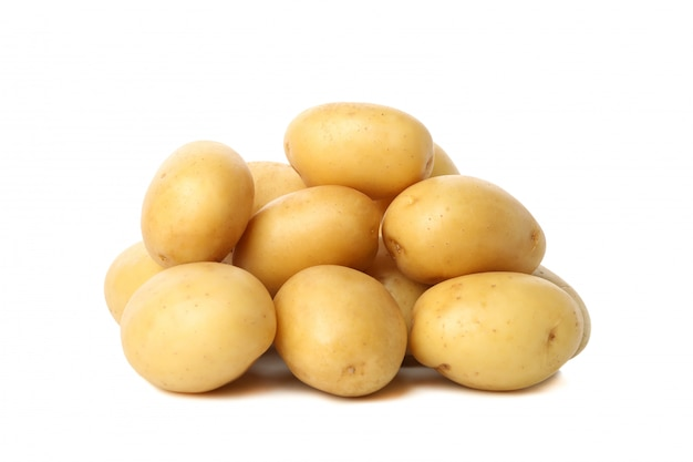 Heap of young potato isolated on white surface