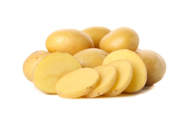 Heap of young potatoes isolated on white surface
