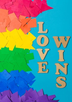 Heaps of paper in bright lgbt colors and love wins words