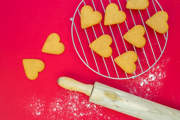 Heart biscuits near rolling pin and grill