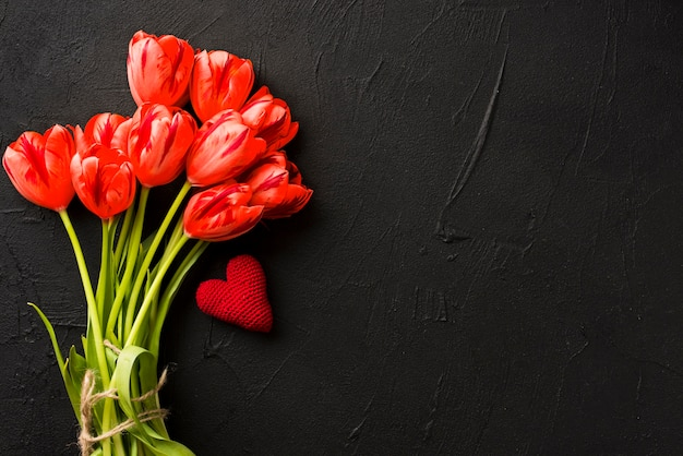 Heart and bouquet of tulips
