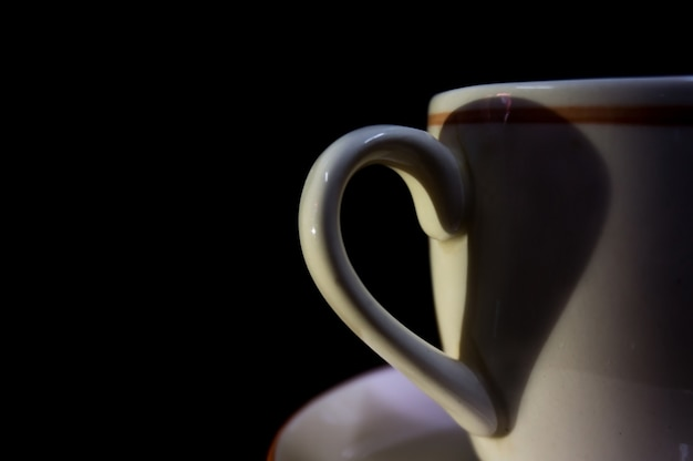 Heart by shadow form the ear of the coffee cup.