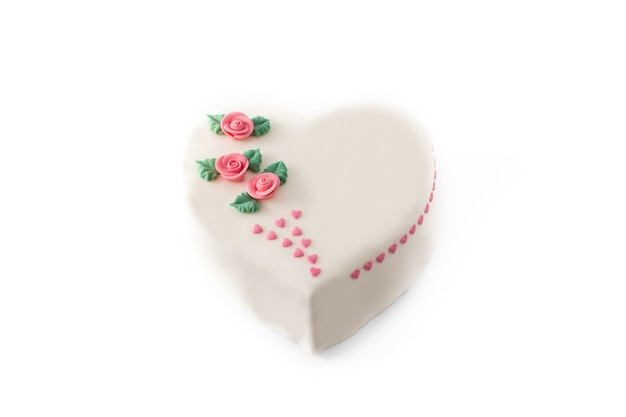 Heart cake for st. valentine's day,  decorated with roses and pink sugar hearts isolated on white background
