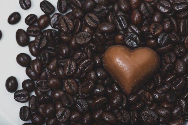 Heart of chocolate on coffee beans