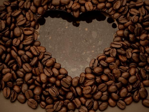 Heart coffee bean inside water.