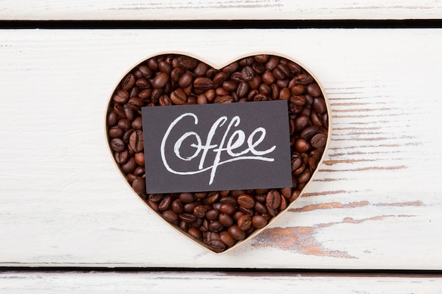 Heart coffee flat lay. coffee love concept. white wood on surface.