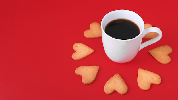 Heart cookies with white coffee cup on table