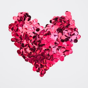 Heart design made of pink confetti