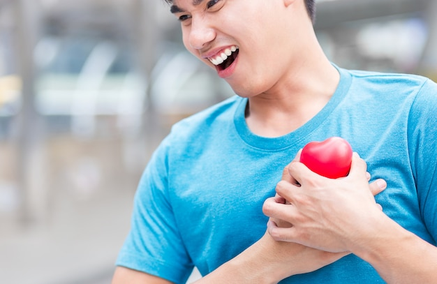 Heart disease with sport man in downtown of business