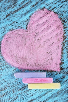 Heart drawn of chalks on wooden