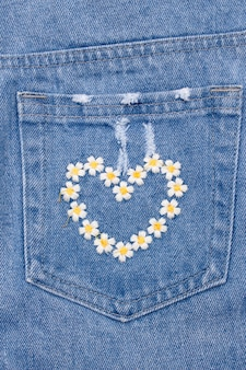 Heart embroidery on back pocket of jeans