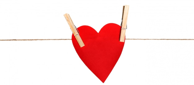 Heart from cardboard on rope with clothespin