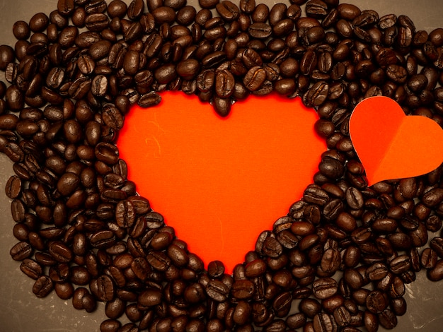 Heart from coffee beans on red