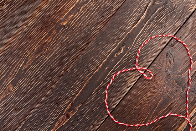 Heart from soft wool thread. shape of heart from thread for knitting and copy space. valentines holiday greeting idea.