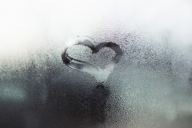 Heart on the glass, a symbol of love