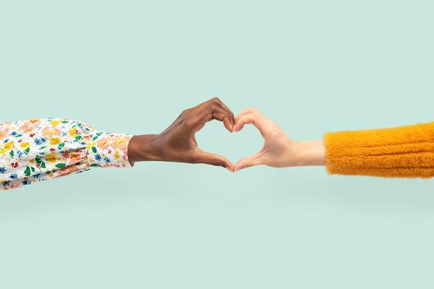 多様性の概念におけるハートの手のジェスチャー