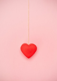 Heart hanging to a string of twine