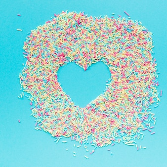 Heart in heap of sprinkles