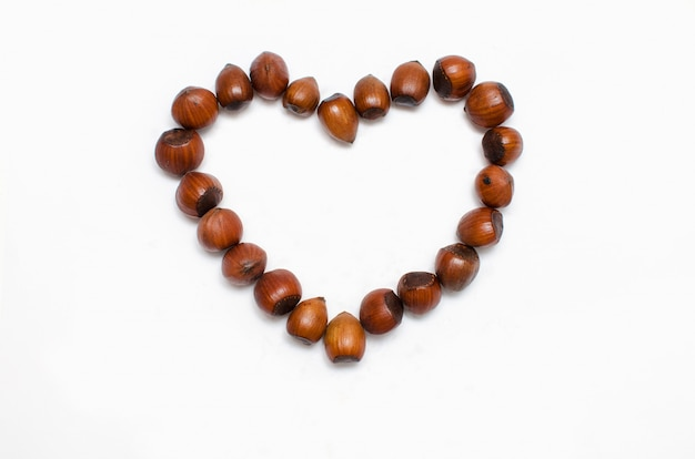 The heart is lined with hazelnut on white background, with a place for the text