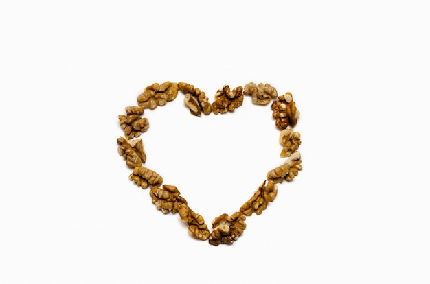 The heart is lined with walnut on white background, with a place for the text