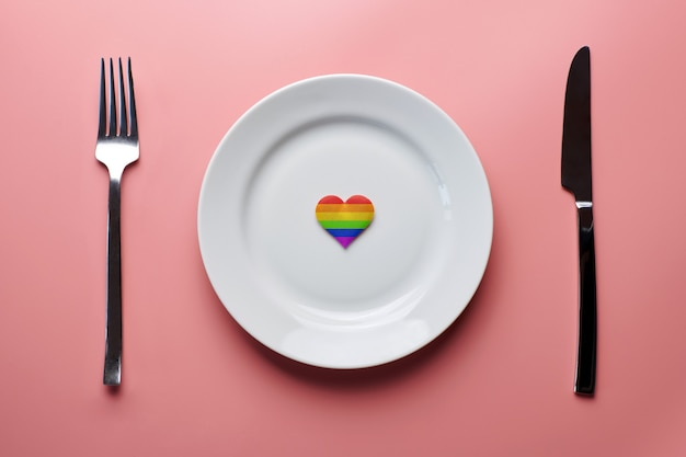 Heart in lgbt flag colors in plate