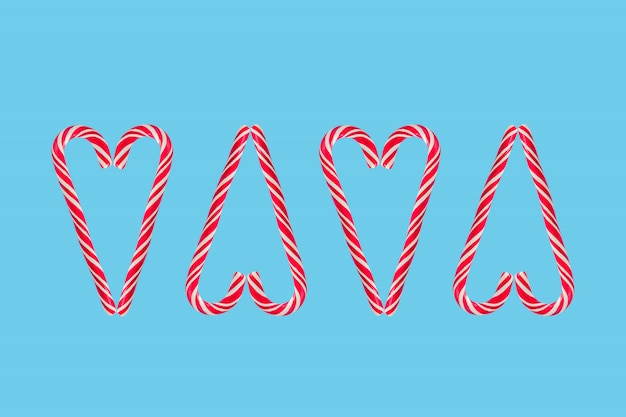 Heart made of candy canes isolated on blue background