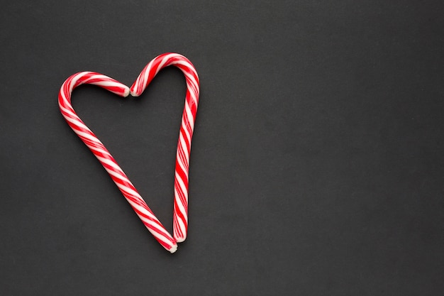 Heart made of candy canes with copy space