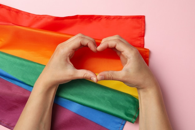 Heart made of female hands with lgbt flag