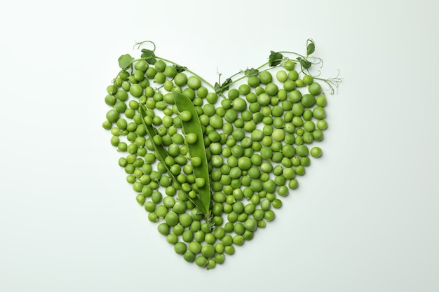 Heart made of pea seeds on white