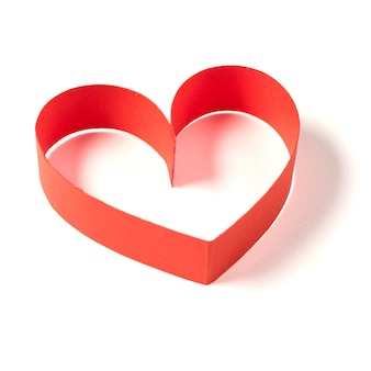 Heart made of ribbon on white background.